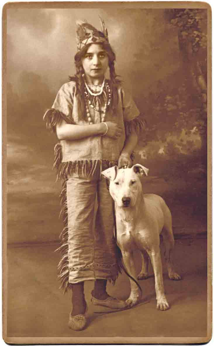 Old-fashioned Bull Terrier and a young lady in her fancy dreess