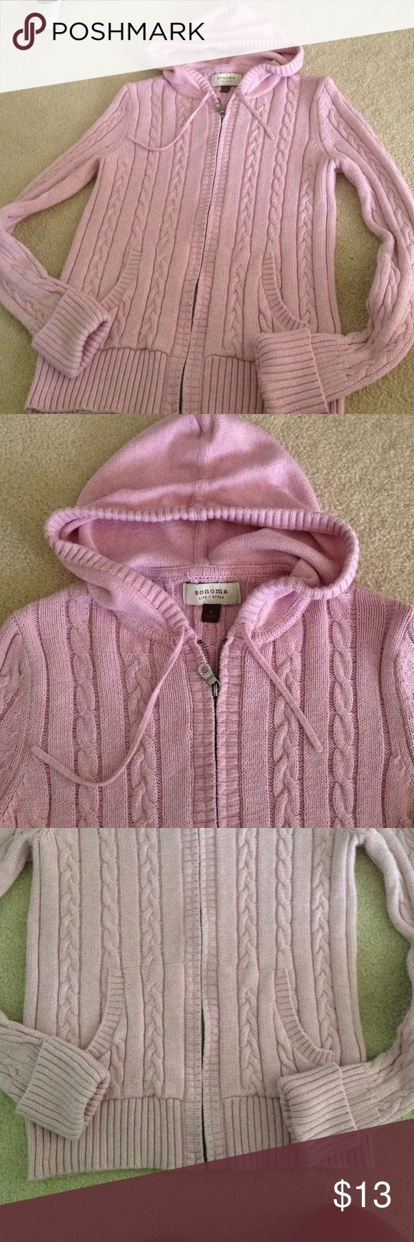 Woman's pink zip up cable knit sweater Light pink zip up sweater with hood.  Size medium and in great condition. No stains holes or pilling. Sonoma Sweaters Cardigans