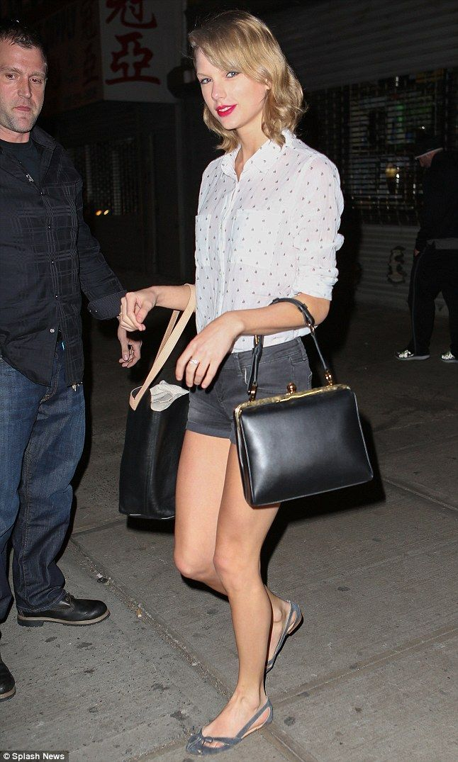 Taylor Swift looked pretty in Rails' Jesse Sailboat button down, denim cutoffs, and carrying both the Kate Spade Saturday Square wide down tote and the Dolce & Gabbana Large Agagta shoulder bag http://dailym.ai/1oMhQ49