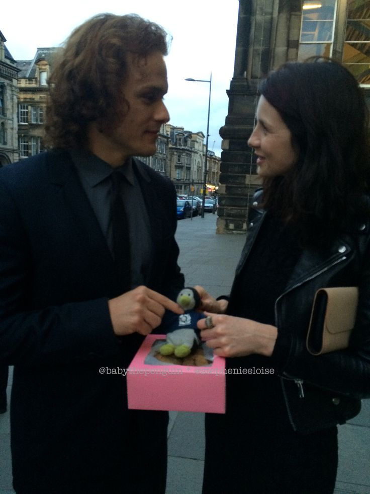 Here's a picture of Sam Heughan and Caitriona Balfe from Edinburgh International Festival From Baby the Penguin: #backingblue (Sam Heughan) v #ShouldertoShoulder (Caitriona Balfe). In the end, Rugb...