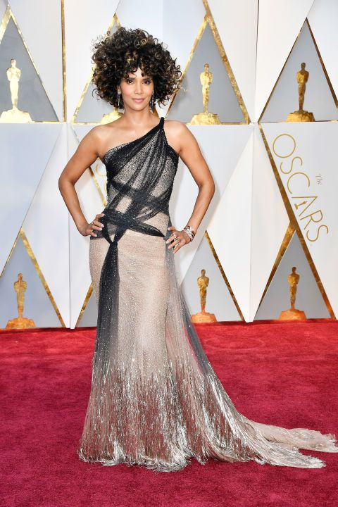 See all the red carpet arrivals at the 89th Annual Academy Awards: Halle Berry in Versace