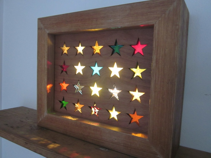 How cool: this light-box is made entirely of reused materials. The glass is recycled antique glass, and the timber frames are made from the flooring of an old school house.