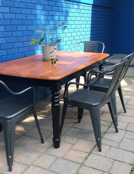 Industrial dining chairs are instantly warmed up with this wood dining table. The set is perfect for feeding a crowd outdoors on your back patio.
