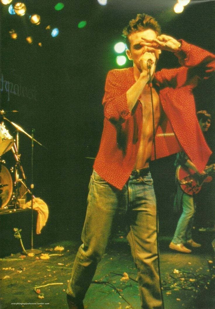 Morrissey and Johnny Marr (in the background): The Smiths live at Markthalle, Hamburg, Germany on May 4,1984. This concert was filmed and broadcast on the German television show 'Rockpalast'.