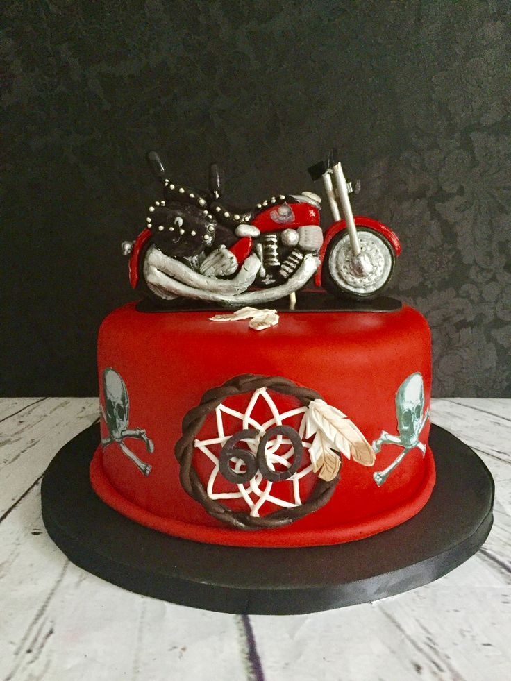 Motorcycle themed 60th Birthday cake Chocolate cake with chocolate German buttercream filling covered with fondant, custom sugar paste motorcycle topper and dream catcher, and edible images.