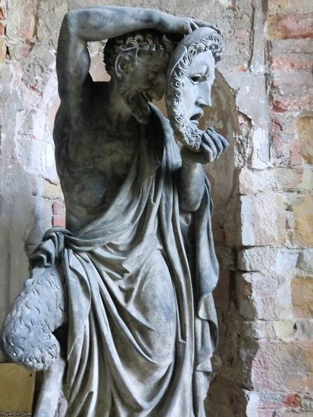 Statue of a masked Pan, the god of the wild,  unbridled male sexuality, and rustic music. He is also directly connected to fertility and to masturbation [taught to him by Hermes]. His homeland is in rustic Arcadia. Pan is also a god with the gift of prophecy.