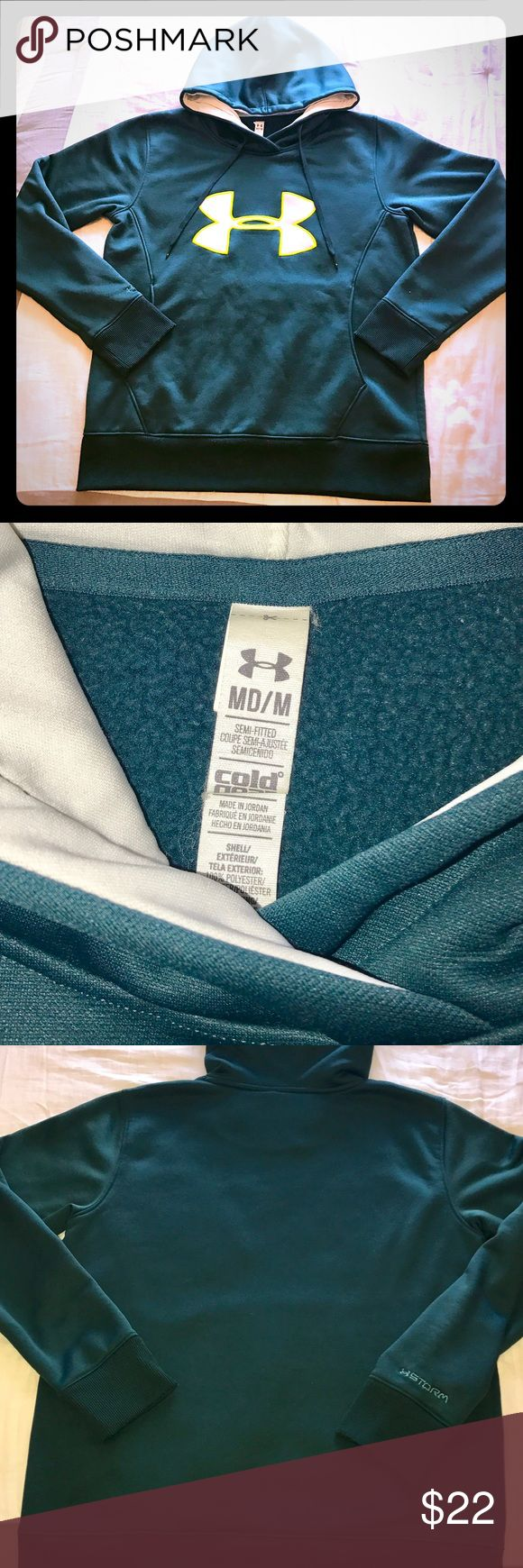 Under Armour Semi Fitted Women's Storm Hoodie; Med Under Armour Semi Fitted Women's Storm Hooded Sweatshirt; size Medium.  Gently worn less then a handful of times.  Looks and feels like new.  Very comfortable and warm go-to sweatshirt.  It's a blue green'ish color with logo letting itself is white lined with a neon yellow detail.  Comes from a pet/smoke free home. Under Armour Tops Sweatshirts & Hoodies