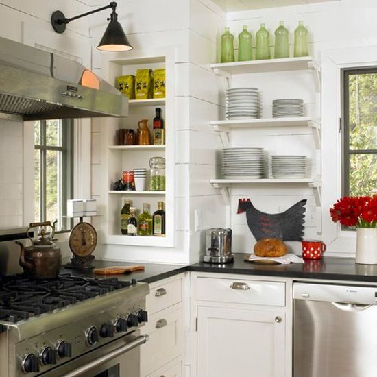 Cottage kitchen.   Planking, open shelving, & swing arm lamp