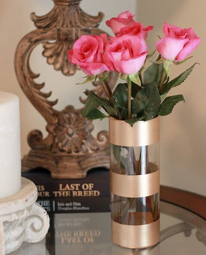 Glam up those glass jars sitting in the cupboard waiting to hold garden cuttings with a little gold spray paint.