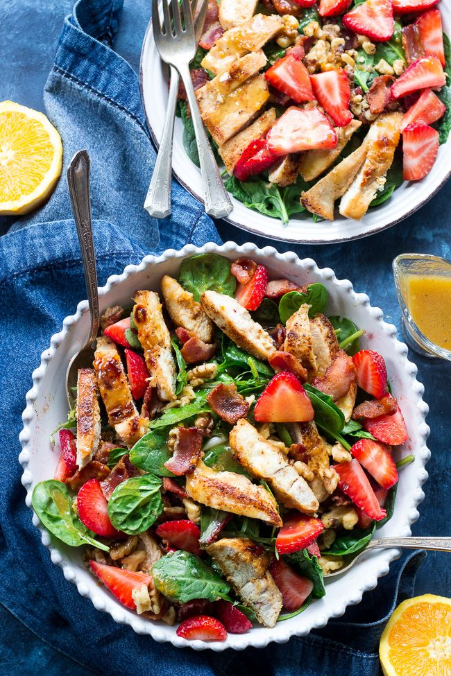 This paleo chicken bacon and strawberry salad with fresh greens and toasted walnuts is tossed with an orange balsamic vinaigrette.