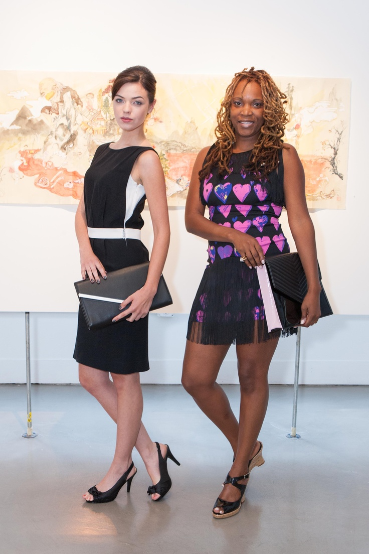 Sara with Jill Milan's Pacific Heights clutch and Tiffany with the Newbury Street portfolio.  Tiffany Keeling on the right with a spring portfolio.