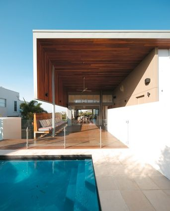 Spotted gum cladding on the inside of the double-height deck was used to create a sense of craft.