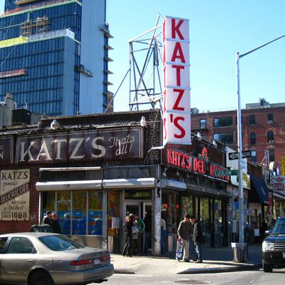 "Katz's Delicatessen Date Opened: 1888 Location: New York, NY Katz's knows cured meats. And smoked meats, matzo ball soup, and every other humble Eastern European comfort food made popular by Jewish delis. Opened by a Russian immigrant family, Katz's dishes up immense corned beef sandwiches, sauerkraut-and-Swiss-stuffed Reubens, knishes, and aged salami, which they'll happily send ""to your boy in the army."" Used as a backdrop for scenes in famous films like When Harry Met Sally, Katz's…"