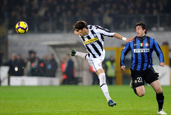 Martin Caceres of Juventus FC competes for the ball with Diego Milito of FC Internazionale Milano during the Serie A match between Juventus and Inter Milan at Stadio Olimpico on December 5, 2009 in Turin, Italy.