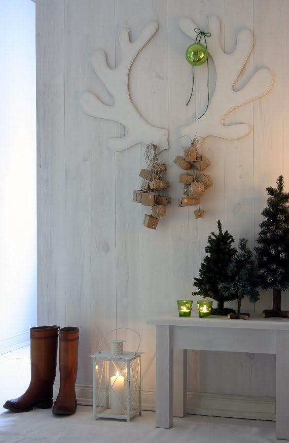 Antlers Advent Calendar. Wouldn't this be awfully pretty with real reindeer antlers to hang the presents from?