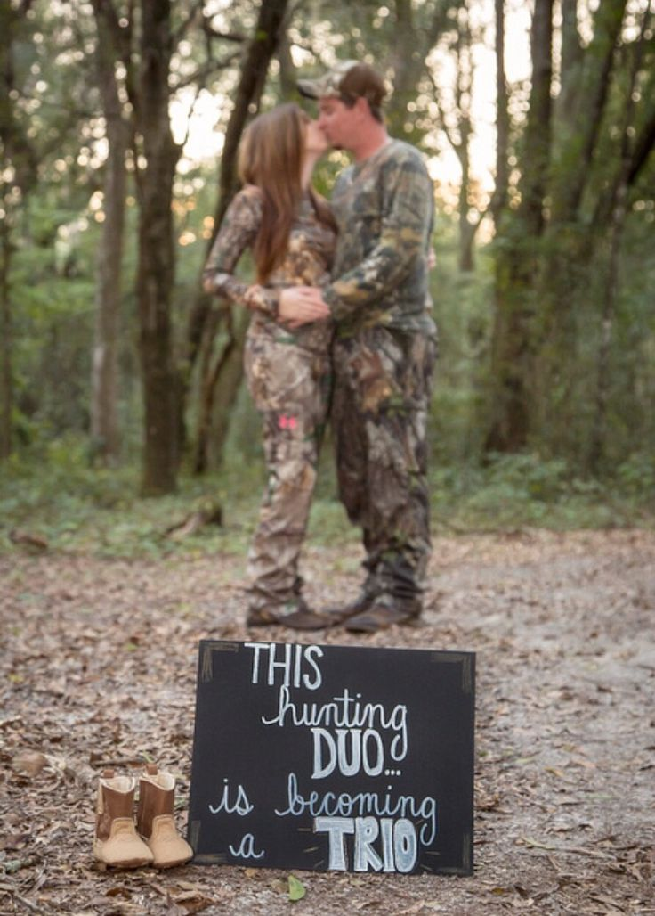 This hunting duo is becoming a trio! hunting pregnancy announcement. Delaine Spradley Photography