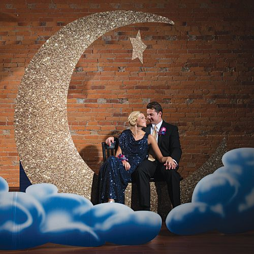 Our To The Moon and Back Photo Setting Kit will have your guests in the clouds with a gold moon that features a printed glitter design.
