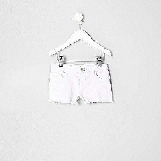 White denim Frayed hems Belt loops Five pockets New improved fit