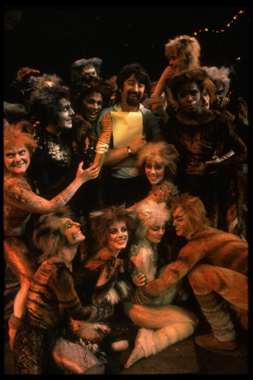 "Director Trevor Nunn surrounded by Cats from the Broadway musical ""Cats."" (New York) - 1982"