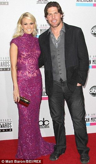 Happily married: Carrie is pictured with husband Mike Fisher last year