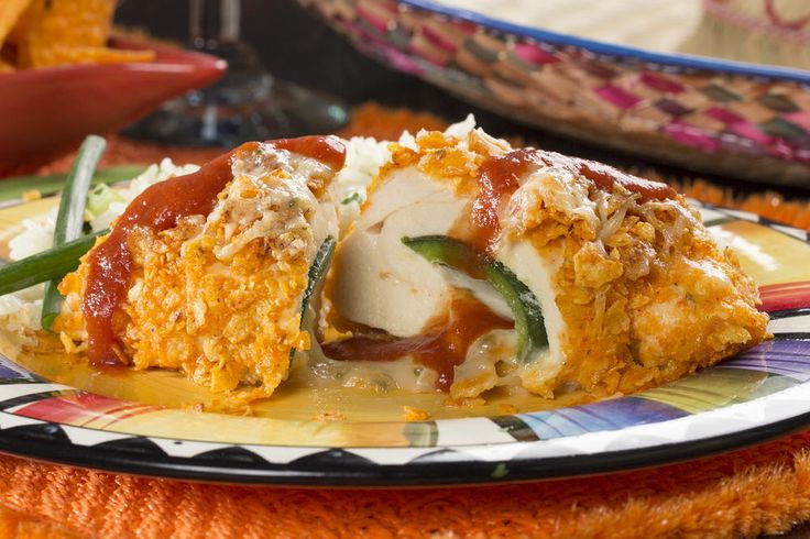 Shake up your dinner routine with this delicious stuffed chile recipe, better known as Chicken Chile Relleno. These chilies are covered in a crispy, cheesy nacho coating, and stuffed with ooey-gooey cheese and chicken.