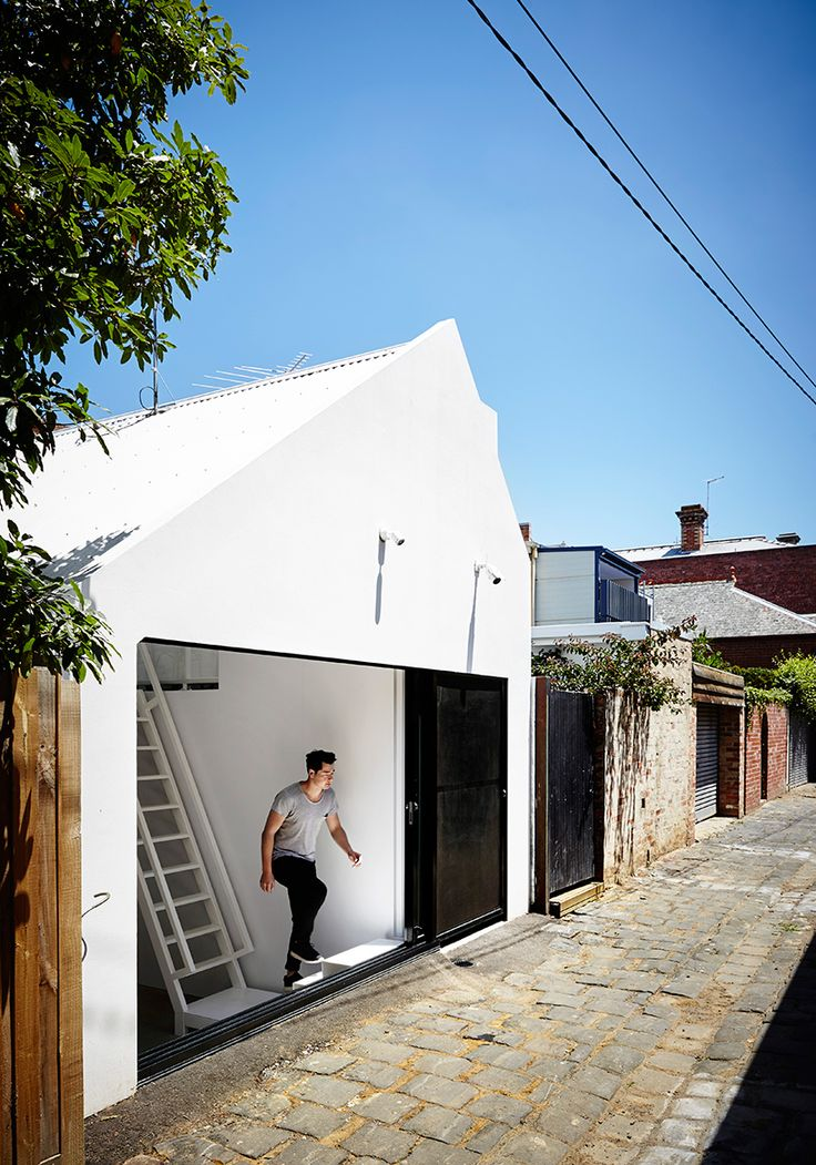 austin maynard architects has completed 'alfred house', the reconfiguration of an existing two-storey terrace that had little relationship with its context.