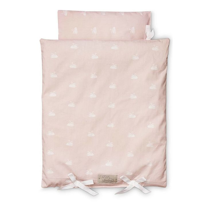 Pretty Doll's Bedding. This set includes a doll's duvet and a pillow, both with organic filling. Little bows are attached at the bottom as an extra re