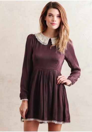 A darling purple dress with a delicate lace accent. The ideal piece for a dressy holiday function this season.