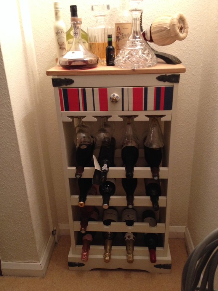 Wine rack made by the staff at 9 lives furniture...a charity organisation providing learning and working opportunities for adults with learning disabilities. We love it's uniqueness as no one else will ever have one like!