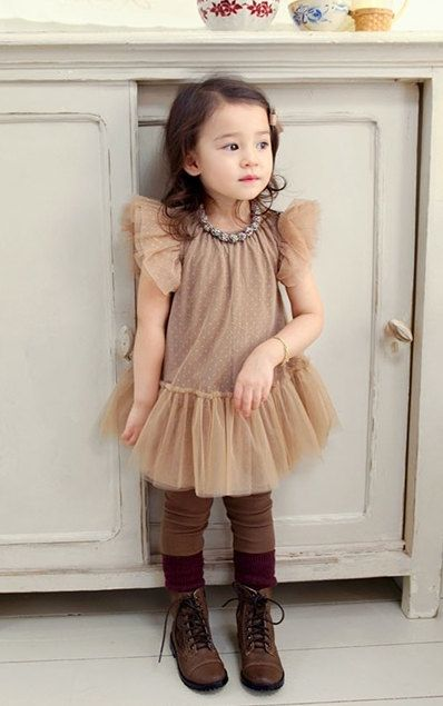 Reminds me of that toddler that wants to be a French sophisticate, but with tulle and tutu.