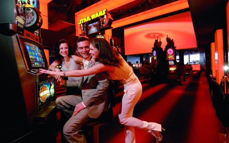 Image result for person playing slot machine