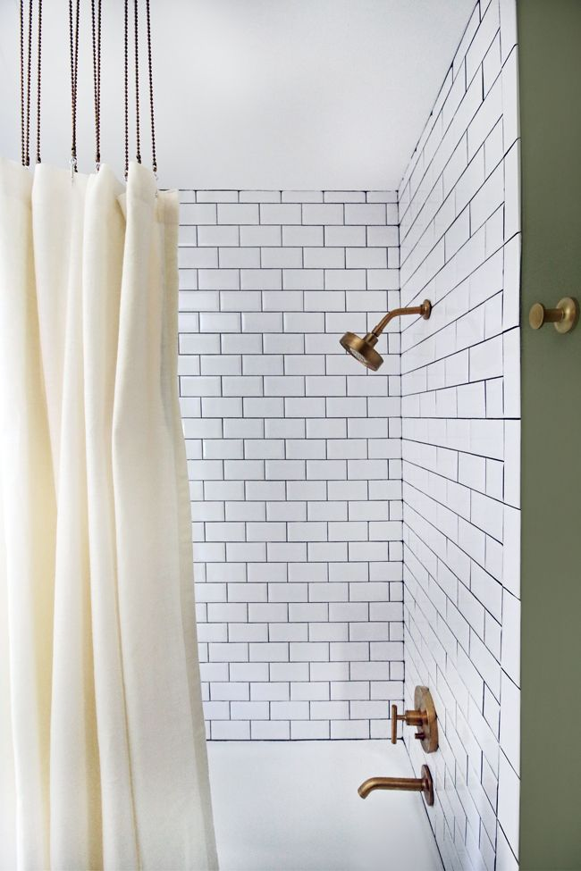 Beveled Subway Tile, Charcoal Grout, Ball Chain Shower Curtain Track & Gold Faucets