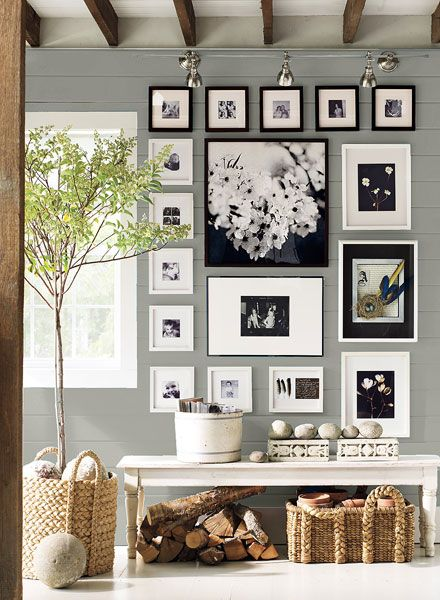 I love this photo wall arrangement!Entryway painted in grey with blue undertones - Benjamin Moore coventry grey for the bedroom?