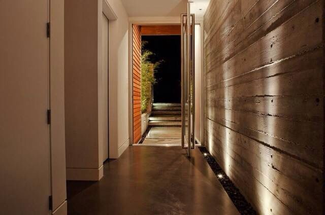 Up lights from the floor are an effective way to add the illusion of height to walls while highlighting textural treatments on the wall such as rammed earth, concrete, cladding, wall coverings or painted effects.