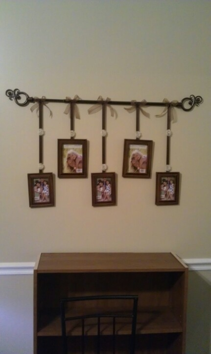 A  cheap curtain hanger, some ribbon, and cheap picture frames... So easy to make!! It only took me about 30 mins to make.