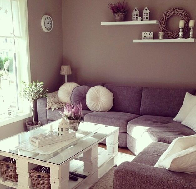 Corner sofa, palette coffee table and taupe walls with staggered shelves