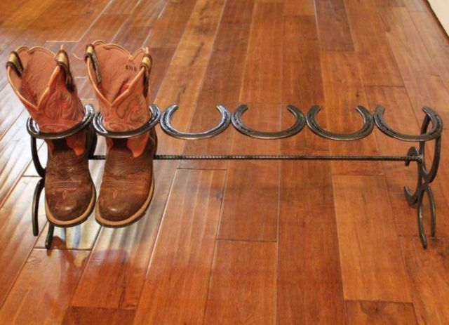 Handcrafted Horseshoe Boot Rack - http://eradaily.com/handcrafted-horseshoe-boot-rack/
