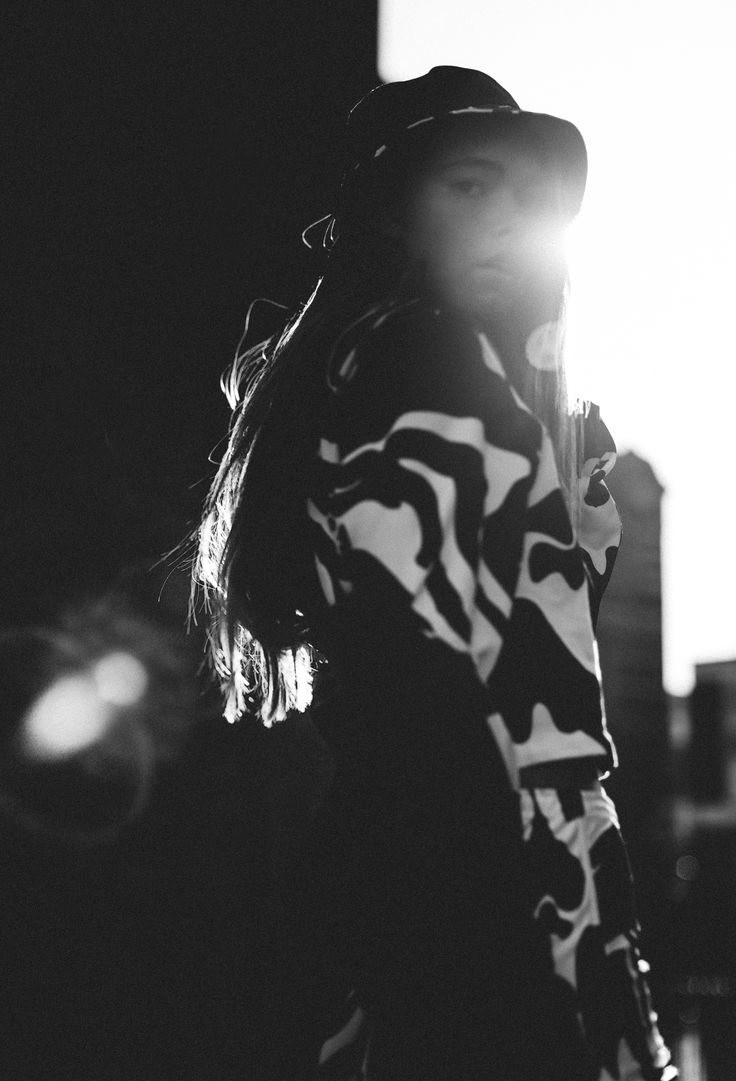 Lily Jean Bridger wears the Black and White Reversible Urban Camo Bucket Hat, the Cropped Urban Camo Sweatshirt and the Urban Camo Shorts >> KUTULA