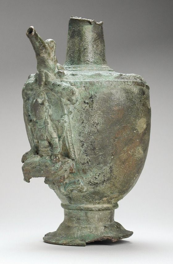 Ewer with Shri Lakshmi Lustrated by Elephants (Gaja-Lakshmi) India, Bihar, Gaya District, 9th century Copper alloy 7 1/4 x 4 x 4 in. (18.42 x 10.16 x 10.16 cm) LACMA, Purchased with funds provided by Harry and Yvonne Lenart (M.85.193.2)