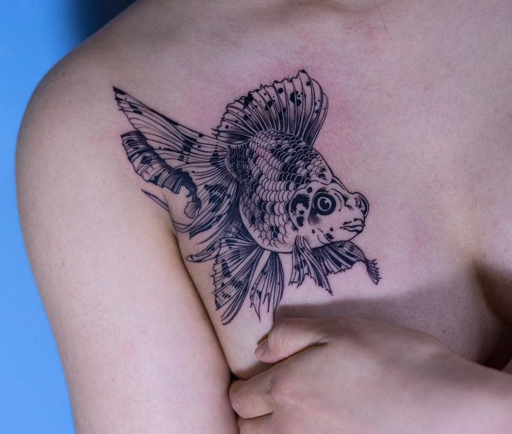 1757 best tattoos images on pinterest for Goldfish tattoo meaning
