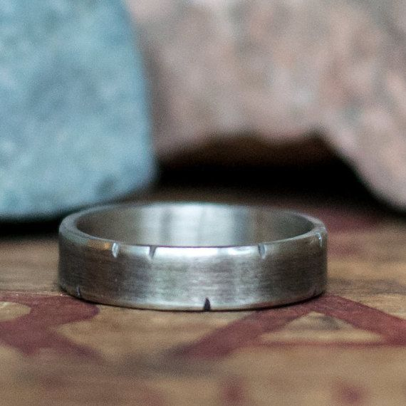 This 14K white gold band features hand applied rustic details which have been sanded smooth to ensure comfortable wear. I then give it a dark patina