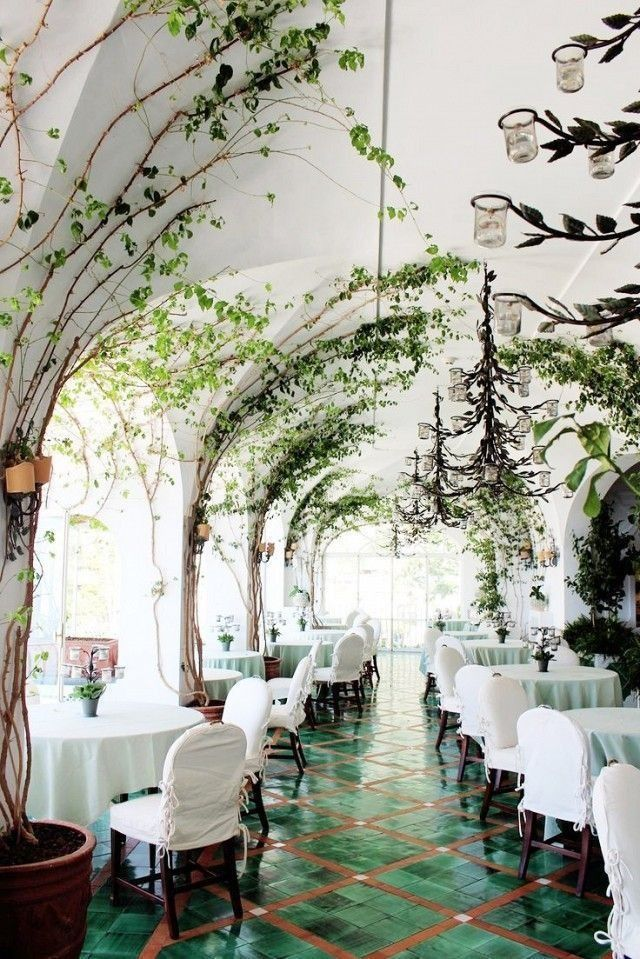 La Sponda restaurant in Positano is draped in climbing vines, arched ceilings and stunning emerald green glazed clay floor tiles.