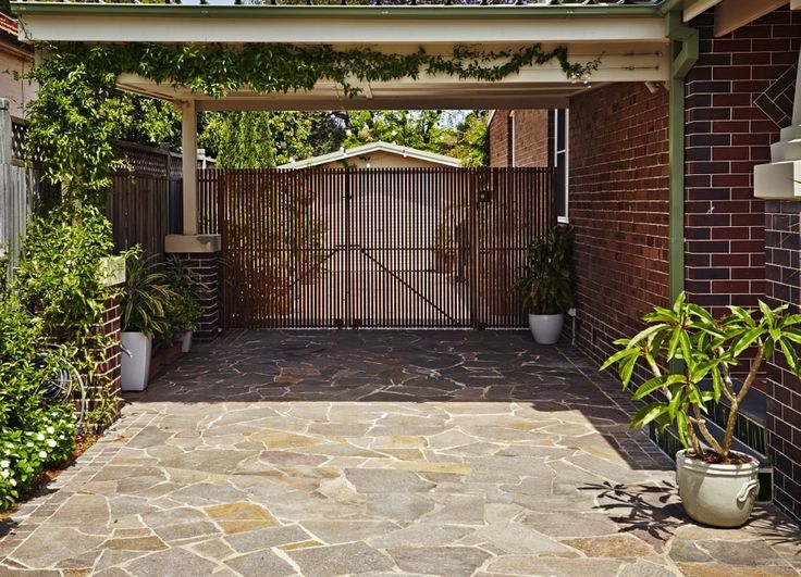 Crazy paved driveway. Unify different spaces by continuing a material throughout.