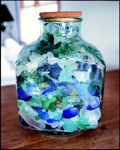 Display Seaglass in a large Glass Jar {Inspiration Only} or SeaGlass Wine bottle. Tutorial on How to make your own sea glass can be found here: http://www.homemadegoodness.org/homemade-sea-glass.html