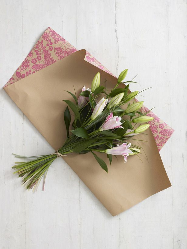 How to Wrap a Bouquet of Flowers -   It's always best to wrap a hand-tied bouquet before you give it to someone as a gift: the wrapping paper helps to protect delicate petals in transit; and a well-wrapped bouquet makes a much more pleasing present.