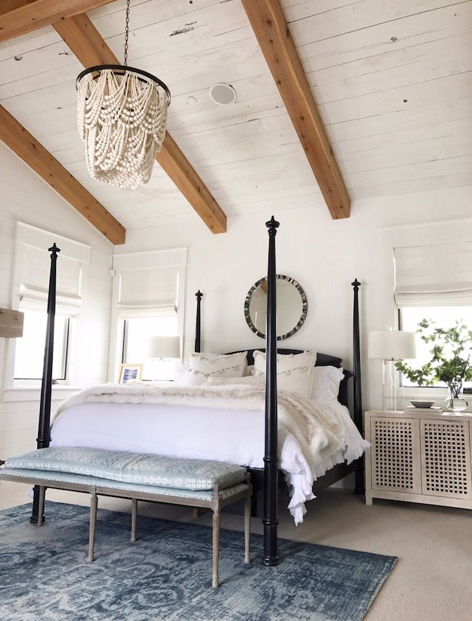 BECKI OWENS- Heber Project Bedroom. Wood bead chandelier and blue over dyed rug are on sale now! Visit the blog for details.