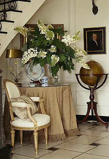 Foyer grouping with skirted table & standing globe - Jackye Lanham
