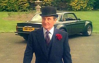 actor Patrick Macnee, alias John Steed and the Broadspeed Jaguar from the New Avengers TV series