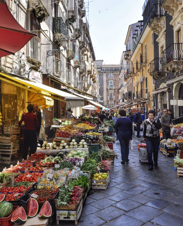 A stroll around Catania's Food Market, Sicily. Love the way they fit anything in flower-lined alleys, especially cafes. Oh, and most things you do, Mt. Etna is in the background. Love the brick oven pizza and vino.