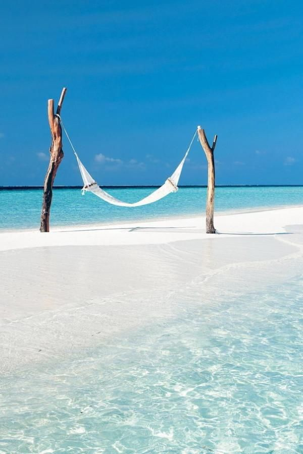 I want to be here right now, swinging on a hammock over white sands, surrounded by the bluest blue.